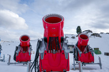 Front View Of Three Snow Cannons In Alpine Ski Resort