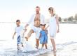 Happy family on sea beach at resort