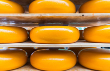 Large Yellow Rounds Of Gouda C...