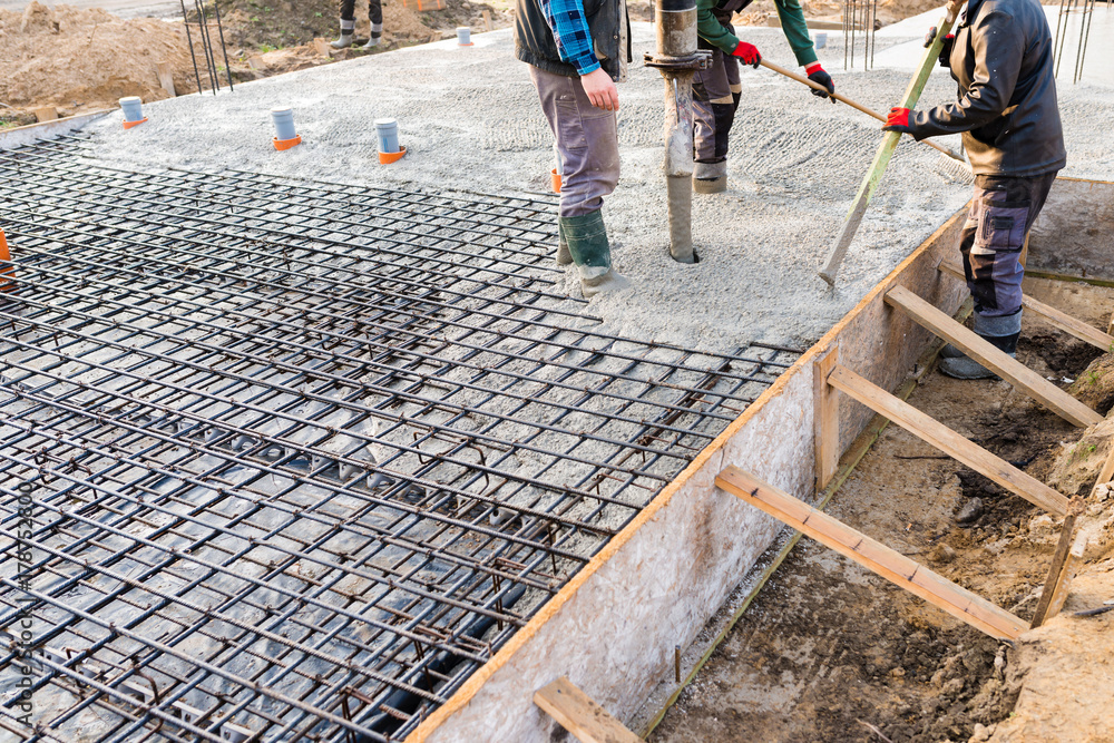 Fototapeta pouring concrete slab - foundation of new house