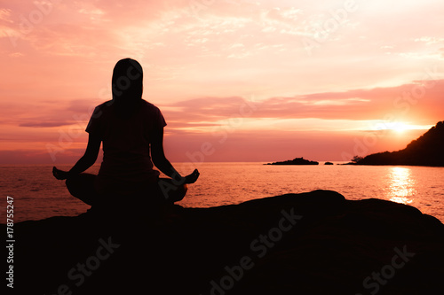 Fotobehang School de yoga Silhouette young asian woman practicing yoga pose at beach,concept for Yoga Sport and Healthy lifestyle