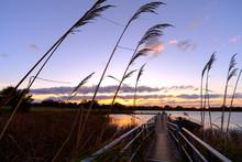 Autumn Lake Fishing Pier At Sunset