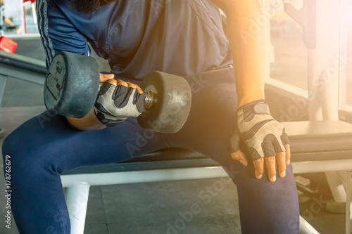 Fototapety, obrazy: Man exercising in fitness gym for good health.