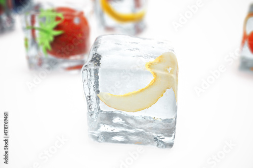 Poster Eclaboussures d eau Melon in ice cube isolated on white with depth of field effects. Ice cubes with fresh berries. Berries fruits frozen in ice cubes, 3D rendering