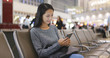Woman looking at cellphone in Hong Kong airport