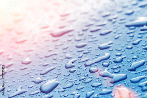 Obraz na płótnie Drops on wet glass in the sunlight, background