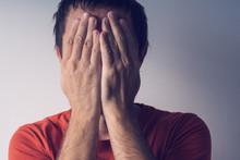 Ashamed Man Covering Face