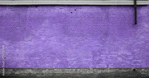 the-texture-of-the-brick-wall-of-many-rows-of-bricks-painted-in-violet-color