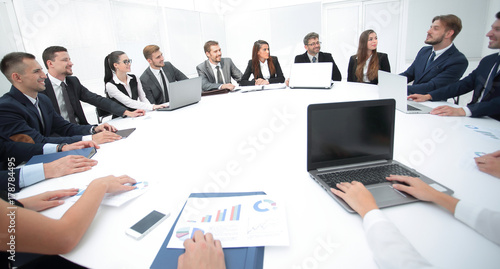 Fotomural meeting of shareholders of the company at the round - table.