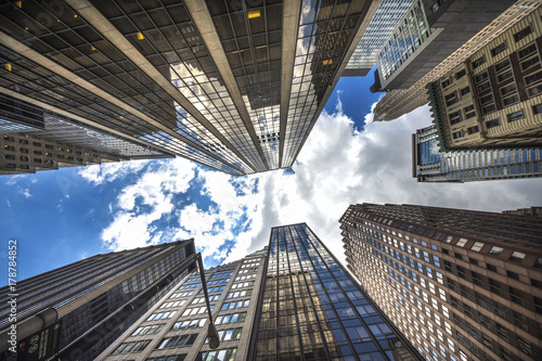 Architectural View of Modern Glass Skyscrapers. Building Against Blue Sky, Manhattan, New York City, New York, USA