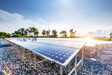 Solar Panel With Cityscape Of ...