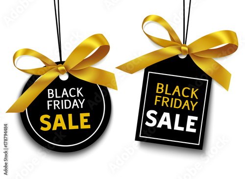 Fotografía  Black friday sale tag with golden bow for your design