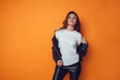 canvas print picture Sexy woman in white t-shirt and jacket on the orange background. Mock-up.