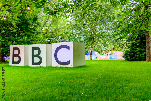 Photo  large bbc sign in park with grass and trees