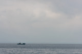 lonely ship floating in sea - 178799867