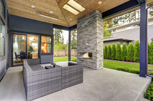 New Modern Home Features A Backyard With Patio