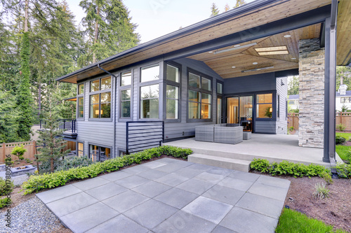 Aluminium Prints Dark grey New modern home features a backyard with patio