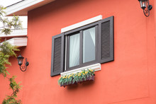 Picturesque Window On Red Wall Of House. Italy Home Style