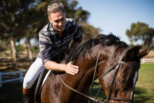 Man Riding A Horse In The Ranch