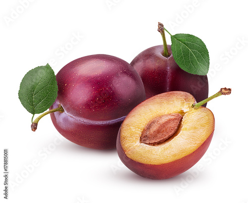 Two Fresh plum with leaf and one cut in half with bone Canvas Print