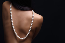 Portrait Of Beautiful Nude Long Straight Black Hair Woman With Pearl Necklace