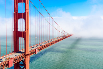 FototapetaGolden Gate Bridge in clouds on a beautiful summer day - Panoramic view from Battery Spencer - California, USA