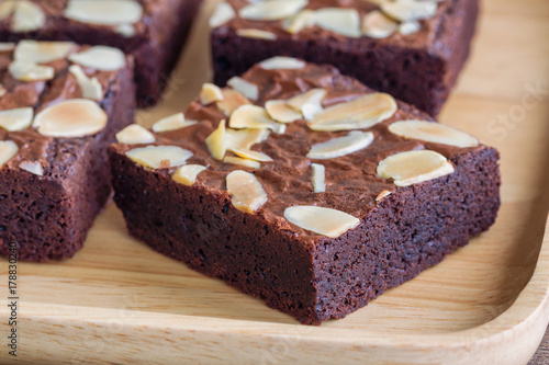 Close up homemade dark chocolate brownies topping with almonds