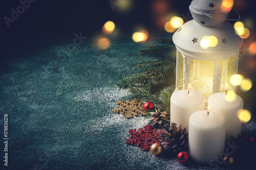 Christmas card with glowing  candle and  lantern on blue background Poster