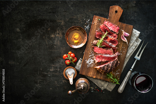 Sliced medium rare grilled beef ribeye steak Canvas Print