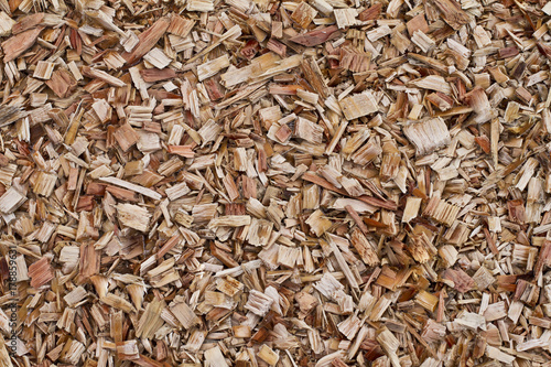 Valokuva  Wood chips background. Fresh wood chips for landscaping