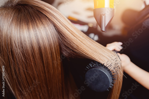 Foto op Plexiglas Kapsalon Close-up of hair dryer for hair drying, concept hair salon, female stylist.