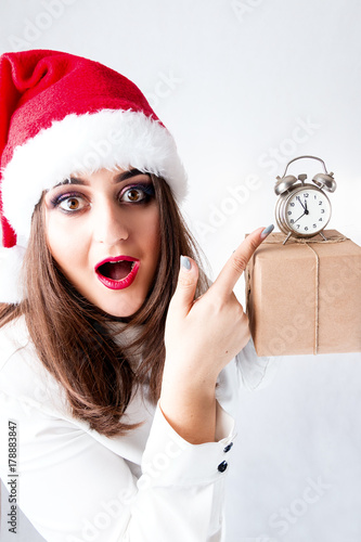 d22e3f31bb14e Happy sweet fat Santa girl. model in santa hat. XXL woman celebrating  Christmas and new year. female holding present and small alarm clock.  orders for .