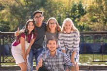 Happy Teenagers Posing On City...