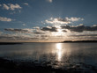 beautiful sunset over harbour coast sea bay clouds silhouette landscape
