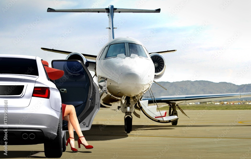 Fototapety, obrazy: Women in red getting ready to boarding a private jet
