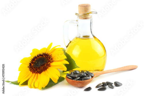 Stickers pour porte Tournesol Sunflower oil in glass jug, seeds and flower isolated on white background