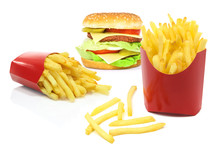 Composite Image Of Fast Food Products - French Fries In Red Carton Boxes And Big Hamburger Isolated On A White Background.