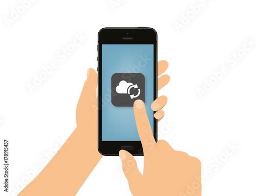 Foto  Hand tippt auf Smartphone - Wolke - Synchronisation