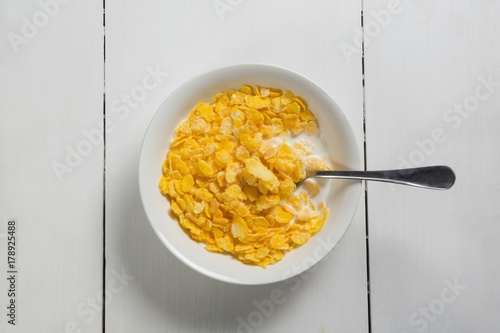 Breakfast cereals in bowl on a wooden table Wallpaper Mural