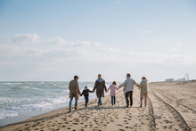 Family Walking Together On Sea...