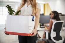 Fired Female Employee Holding ...