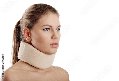 Carta da parati Close up of young female wearing neck collar on white background
