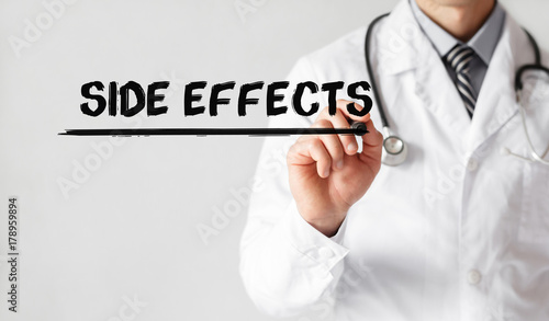 Doctor writing word Side Effects with marker, Medical concept Wallpaper Mural