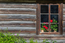 Ancient Window With Flowers Old Wooden House. Background Of Wooden Walls