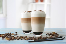 Glasses With Latte Macchiato On Blurred Background