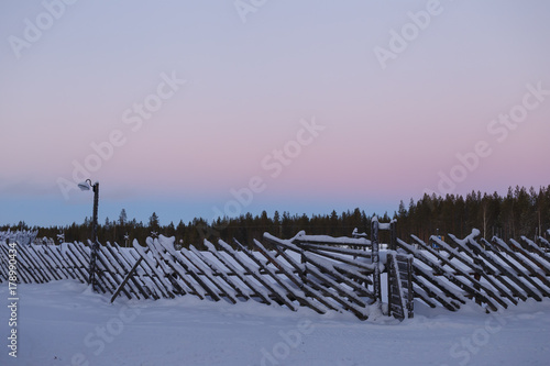 Tuinposter Purper old vintage fence in winter in the village