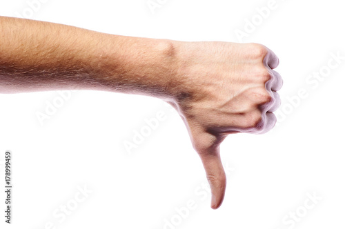 The Man Gestures His Disapproval The Thumb Is Pointing Down The