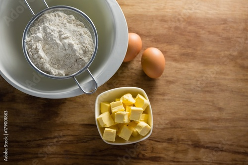Foto op Plexiglas Chocolade Flour in strainer with eggs and cheese