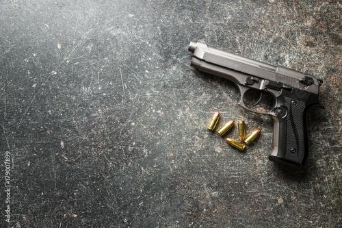 Photo  9mm pistol bullets and handgun.
