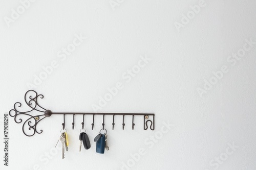 Various keys hanging on hook Canvas Print